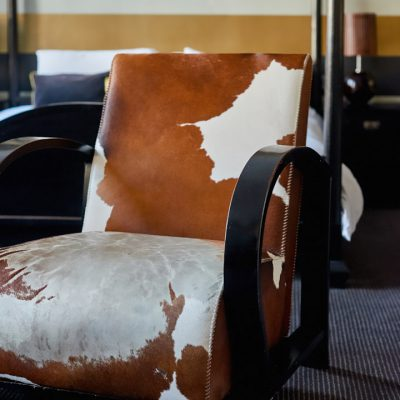 Cinnabar Hotel Room - Cow hide chair