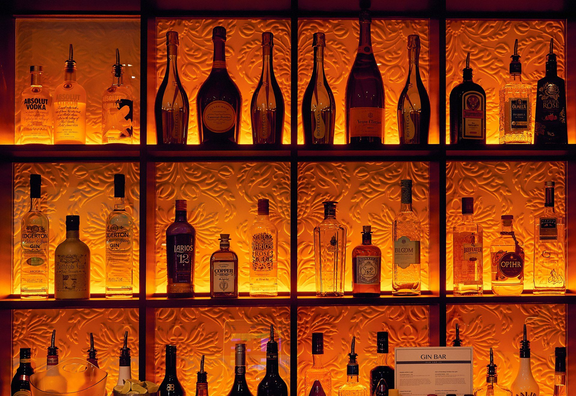 Bottles of drink behind bar